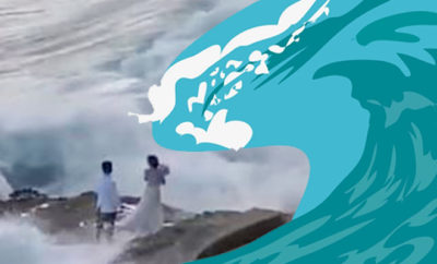 FI Wedding Couple Swept Off Their Feet By A Giant Wave