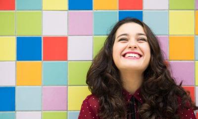 Women smile more than men