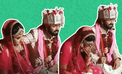 Groom puts hand on bride wedding