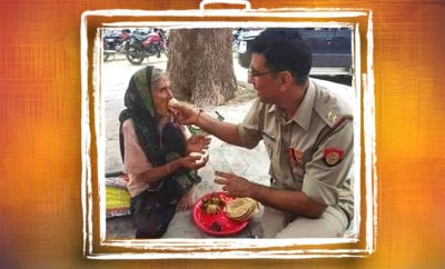 FI-Cop-feeds-poori-and-sabji-to-elderly-woman,-picture-goes-viral