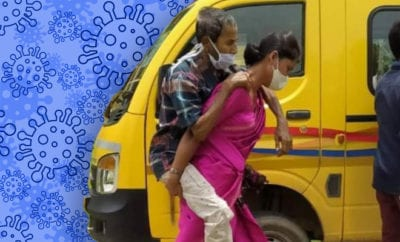 Viral-photo-shows-Assamese-woman-carrying-Covid-positive-father-in-law-on-back