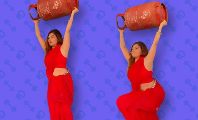 Woman-dons-a-red-saree-and-does-squats-with-33kg-gas-cylinder,-netizens-in-awe