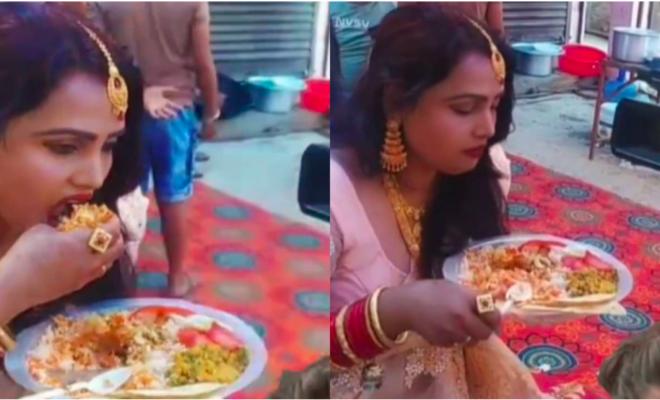 Woman eating at wedding buffet