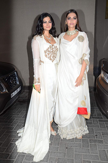 Rhea Kapoor and Sonam Kapoor spotted wearing Anamika Khanna at Masaba Gupta's sangeet.