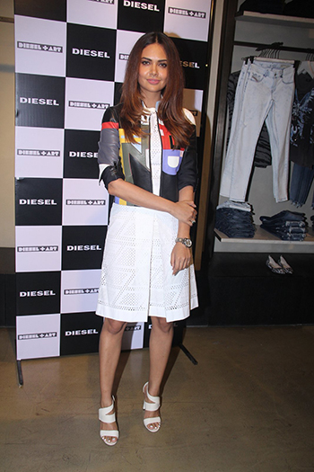 Esha Gupta paired her white dress with a contrast jacket, both from Fendi and Jimmy Choos