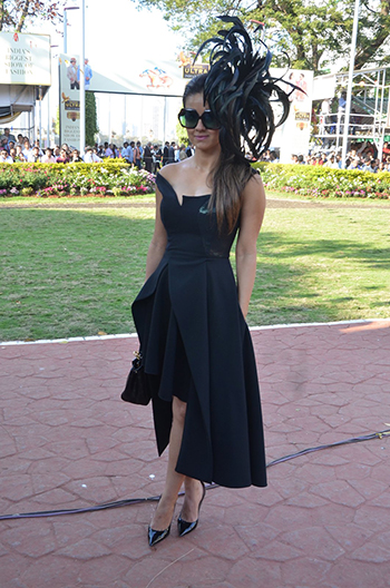 Natasha Poonawala wore a an off-shoulder Stella McCartney dress with a Fendi mini
