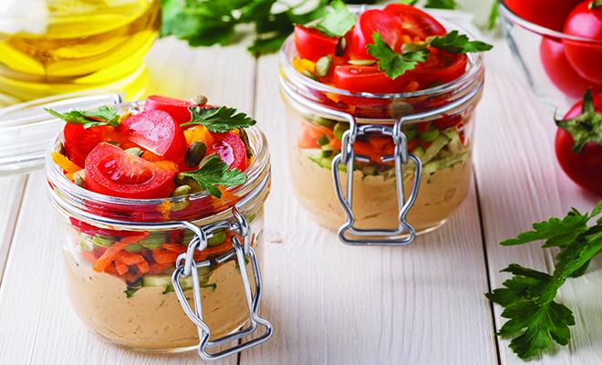 cute little hummus veggie salad in a tiny jar