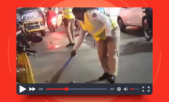 Fl-Woman-Police-Constable-Sweeps-Road-to-Remove-Broken-Glass-pieces
